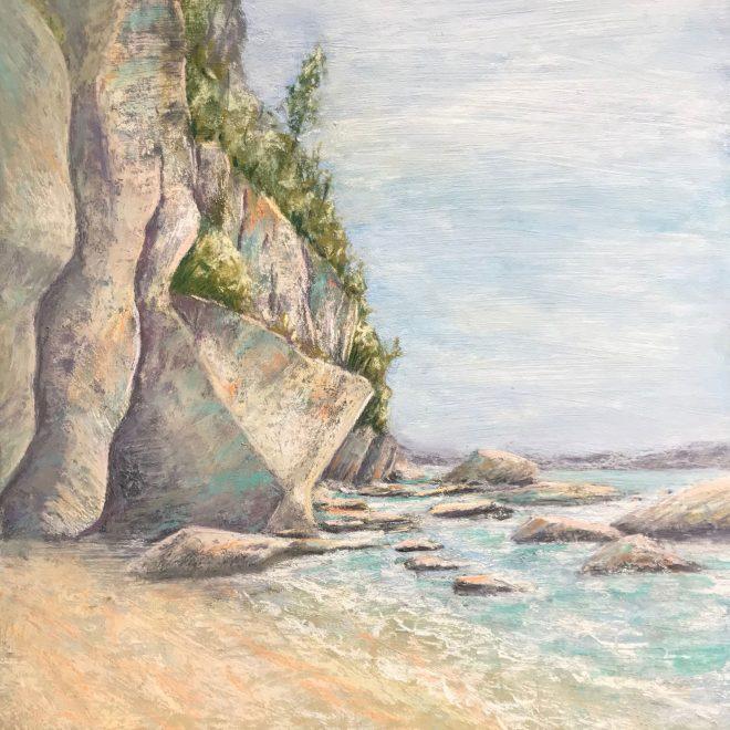 A rocky cliff lies at the breaker's edge (Lynn Norton)